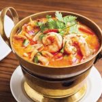 215 Spicy Soup With Exotic Thai Herbs, Straw Mushroom, Lemongrass, Kaffir Leaves And Coriander In A Clear Chicken Soup